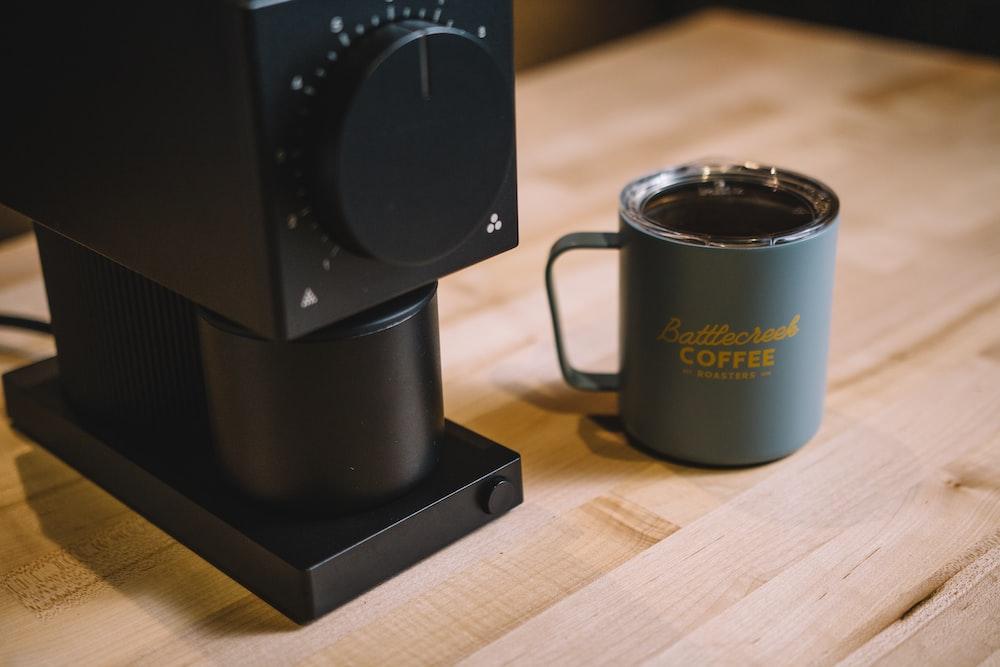 black coffee mug on brown wooden table
