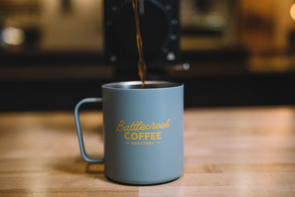 blue ceramic mug with coffee