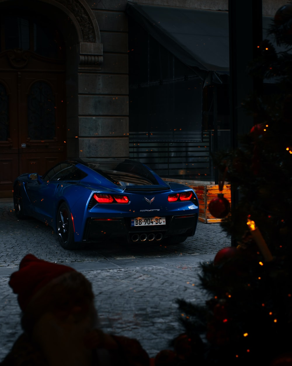 blue bmw m 3 parked on street during nighttime