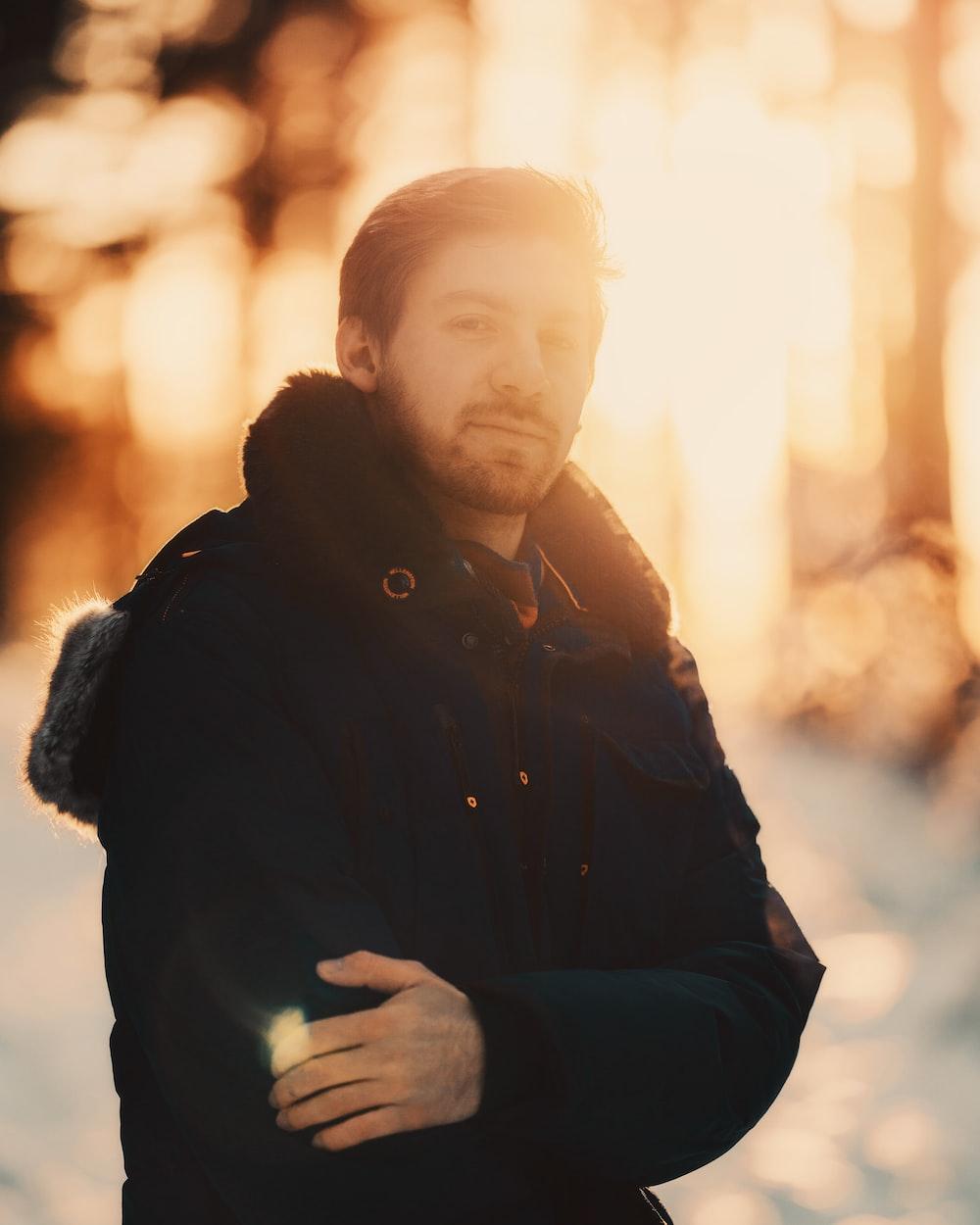 man in black jacket standing during daytime