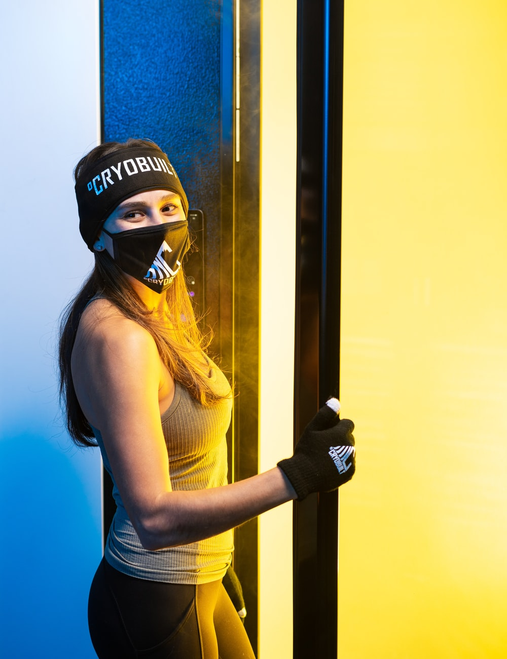 woman in yellow tank top wearing black and white helmet