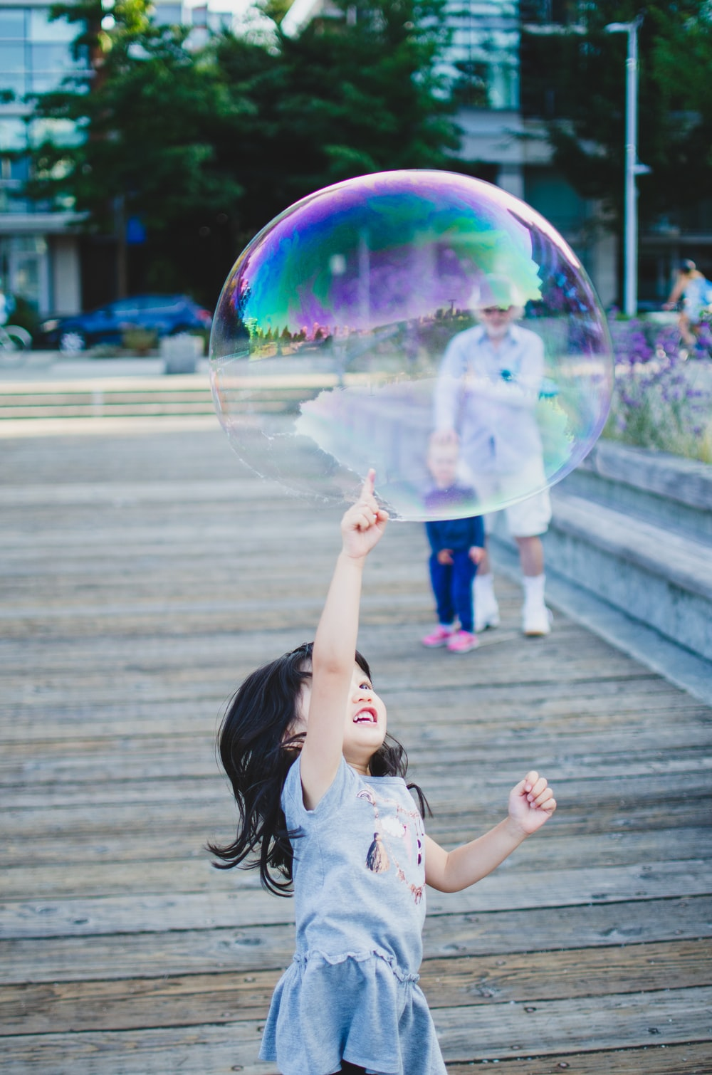 girl in white shirt playing bubbles