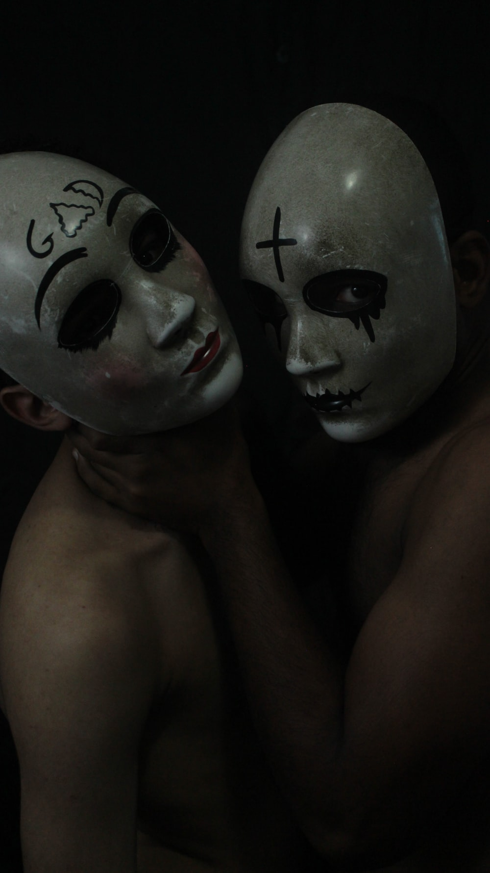 2 person with black and white mask