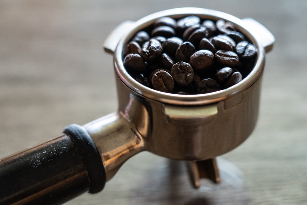 coffee beans in stainless steel cup