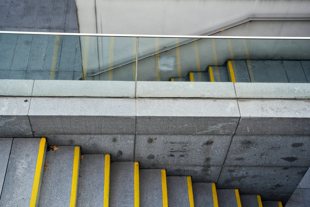 yellow and gray concrete staircase