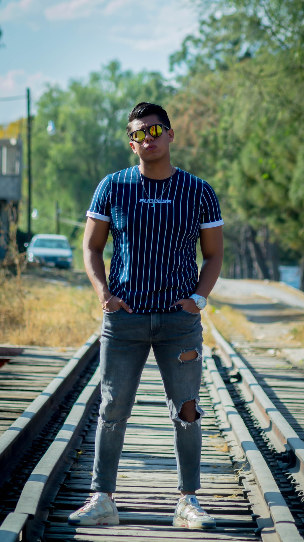 man in blue and white stripe crew neck t-shirt and blue denim jeans standing on with with with with