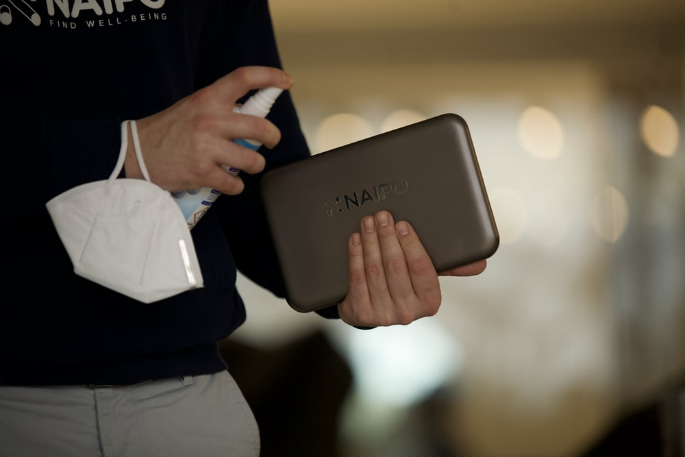person holding gray samsung tablet computer