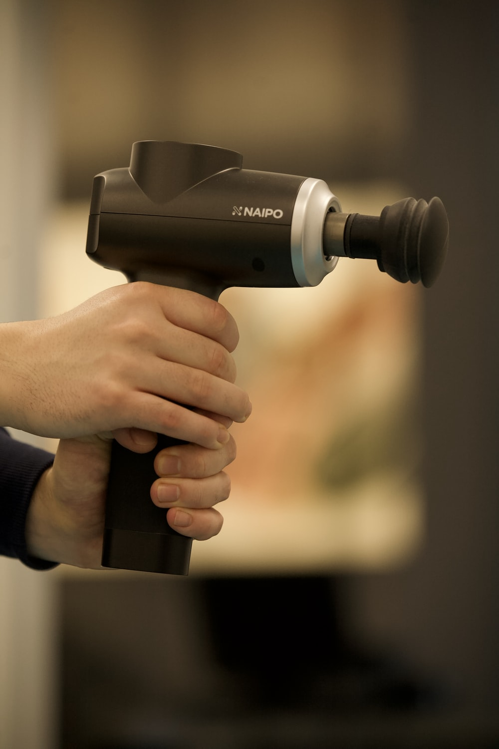 person holding black and gray cordless hand drill