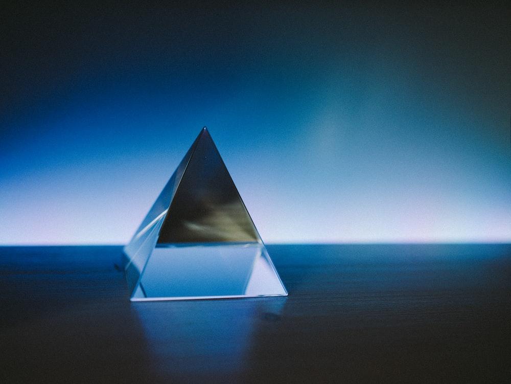 white pyramid on blue sky