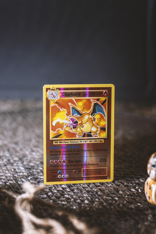 pokemon trading card on gray textile