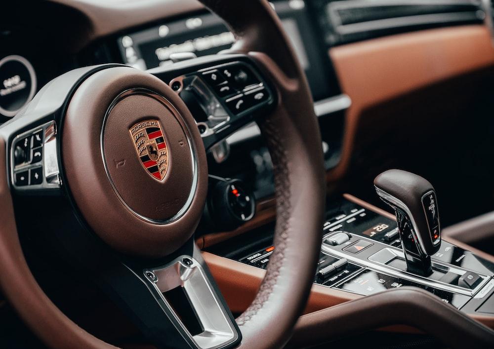 black and brown nissan steering wheel