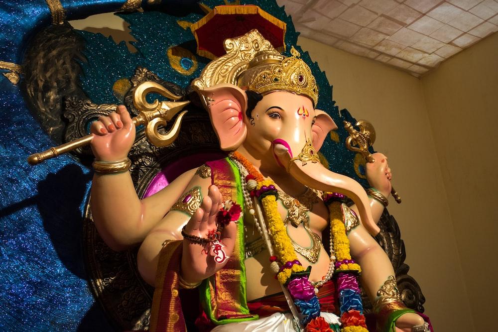 hindu deity with gold and purple headdress