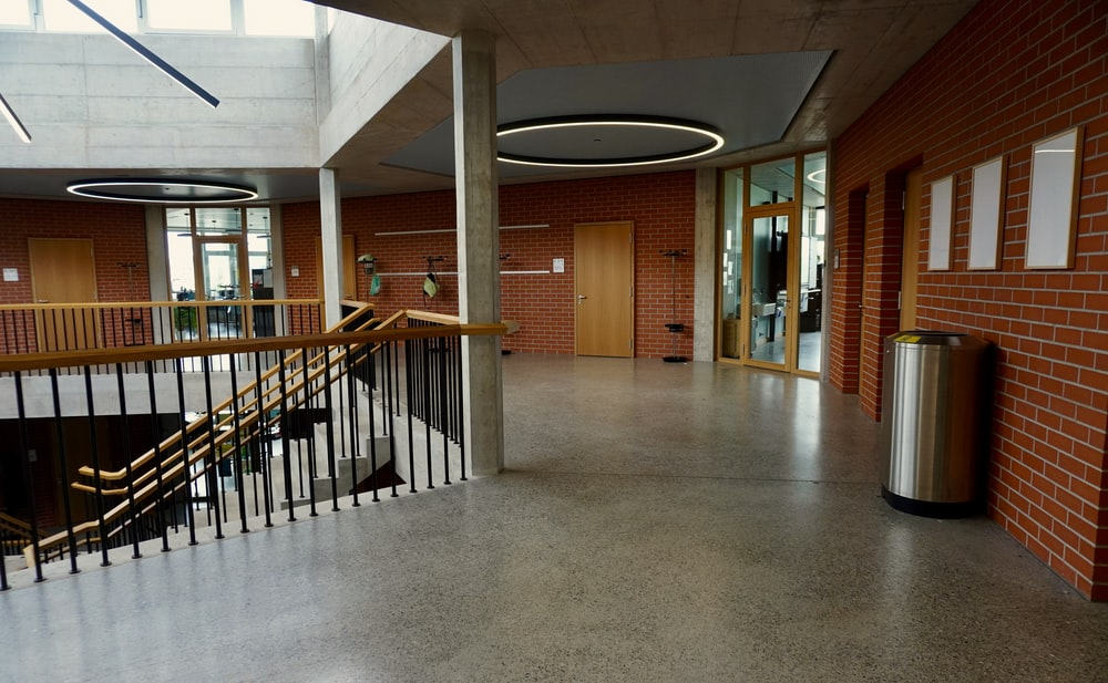 brown wooden door near white concrete staircase