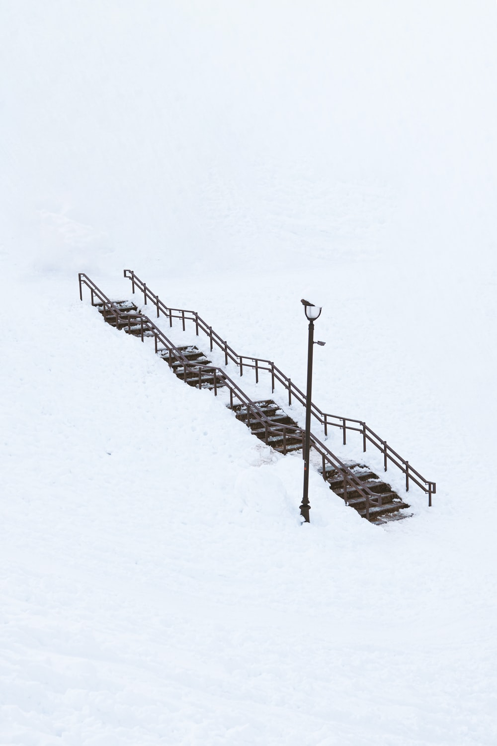 black metal ladder on snow covered ground