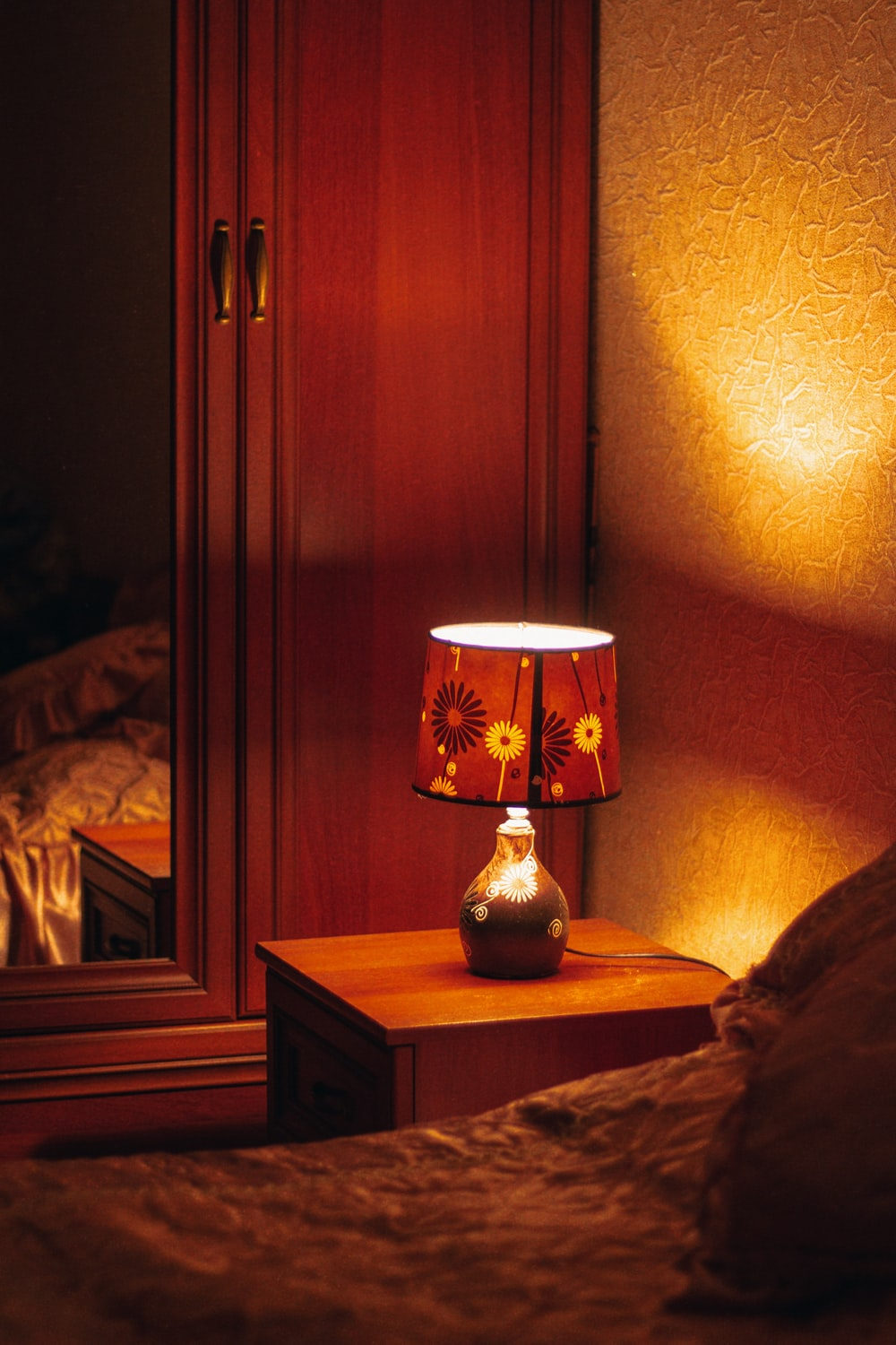 brown and white table lamp on brown wooden table