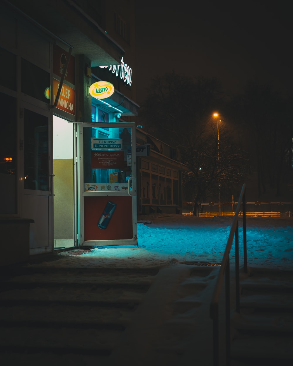 white and red store front during night time