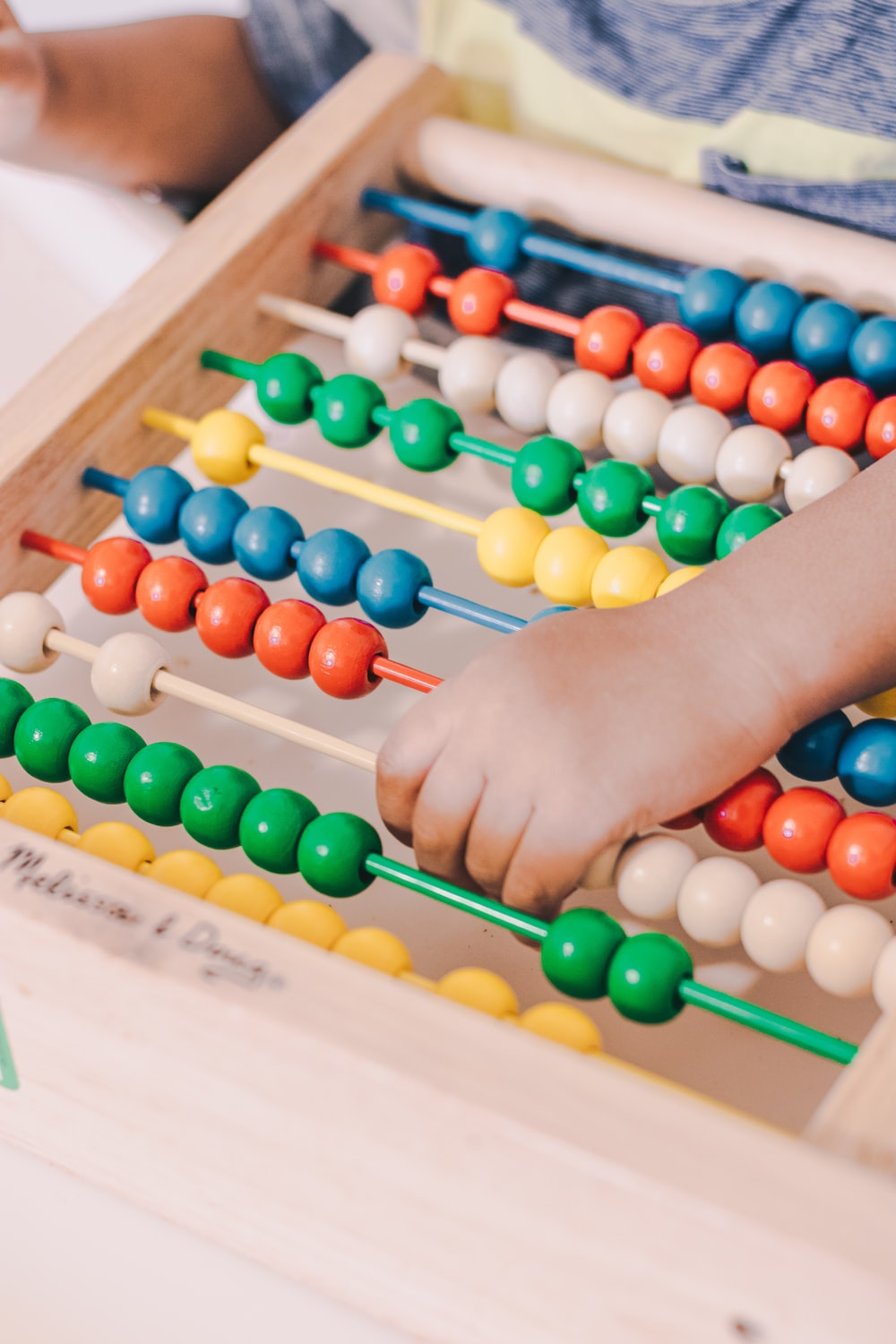 person holding red and blue abacus