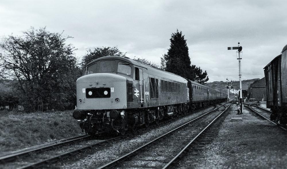 gray and black train on rail tracks