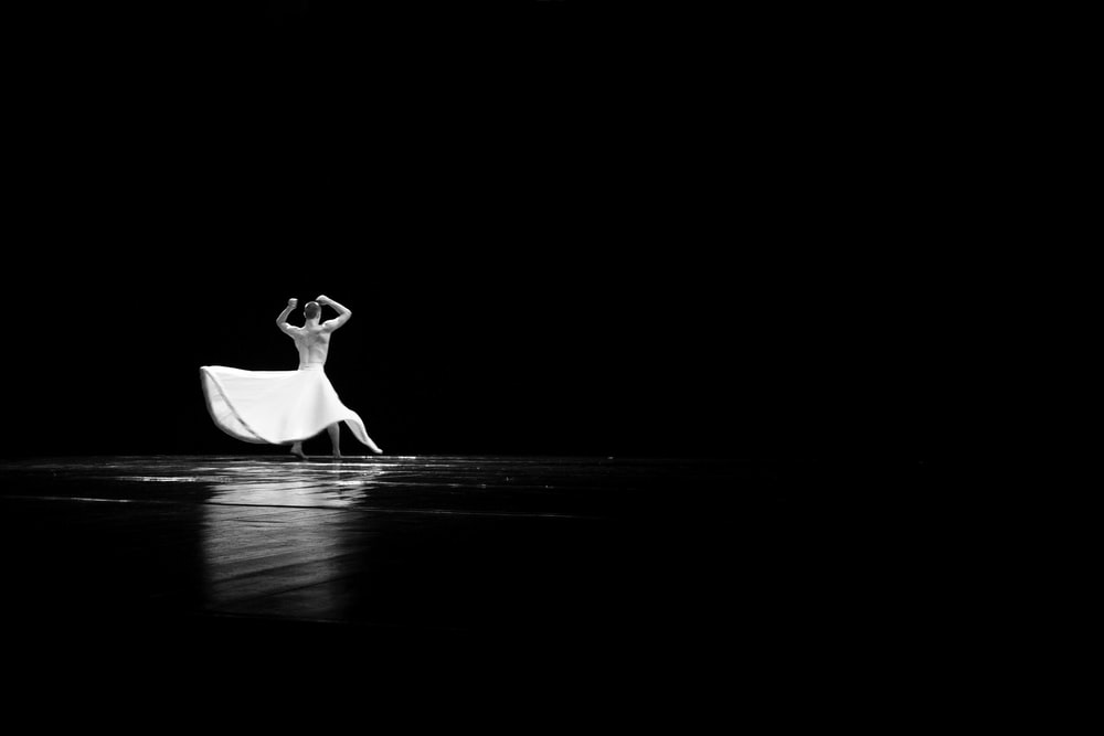 woman in white dress walking on water