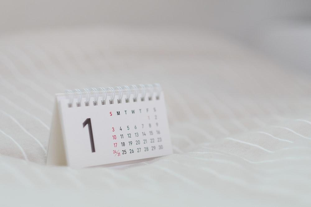 white calendar on white textile