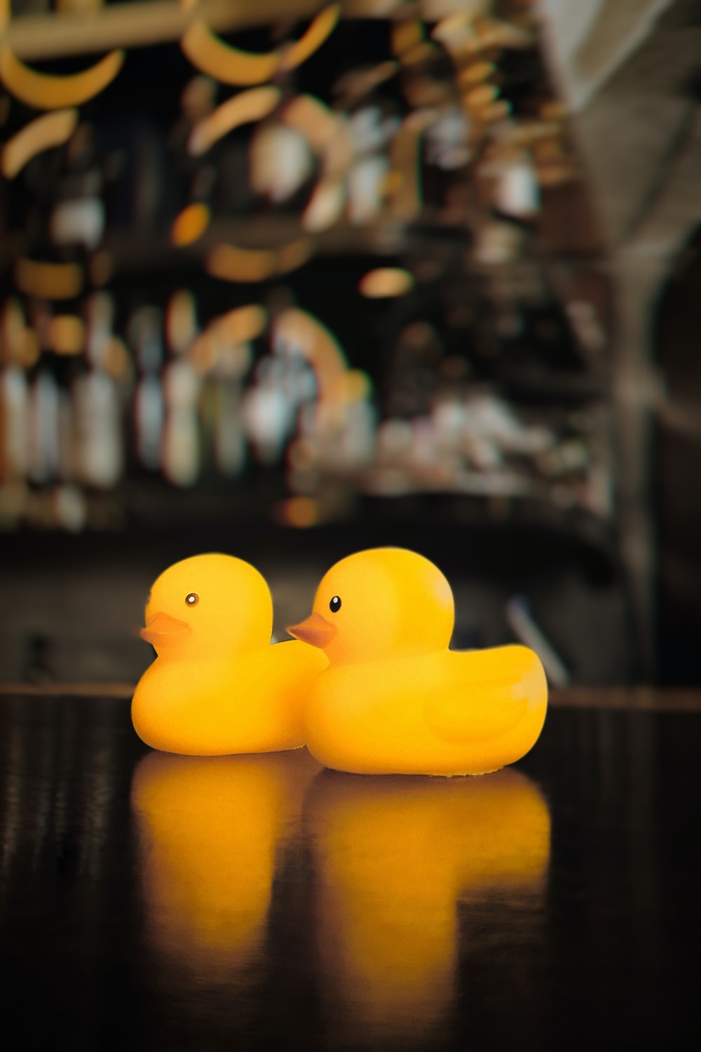 yellow rubber duck on brown wooden table