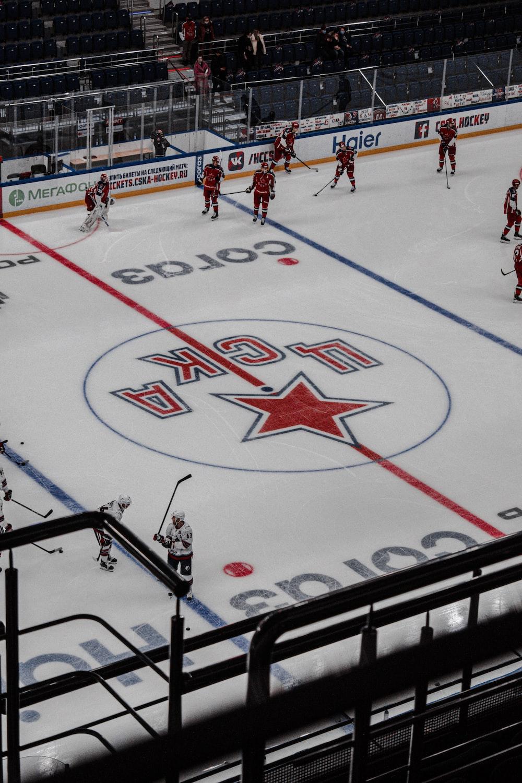 people playing ice hockey during daytime