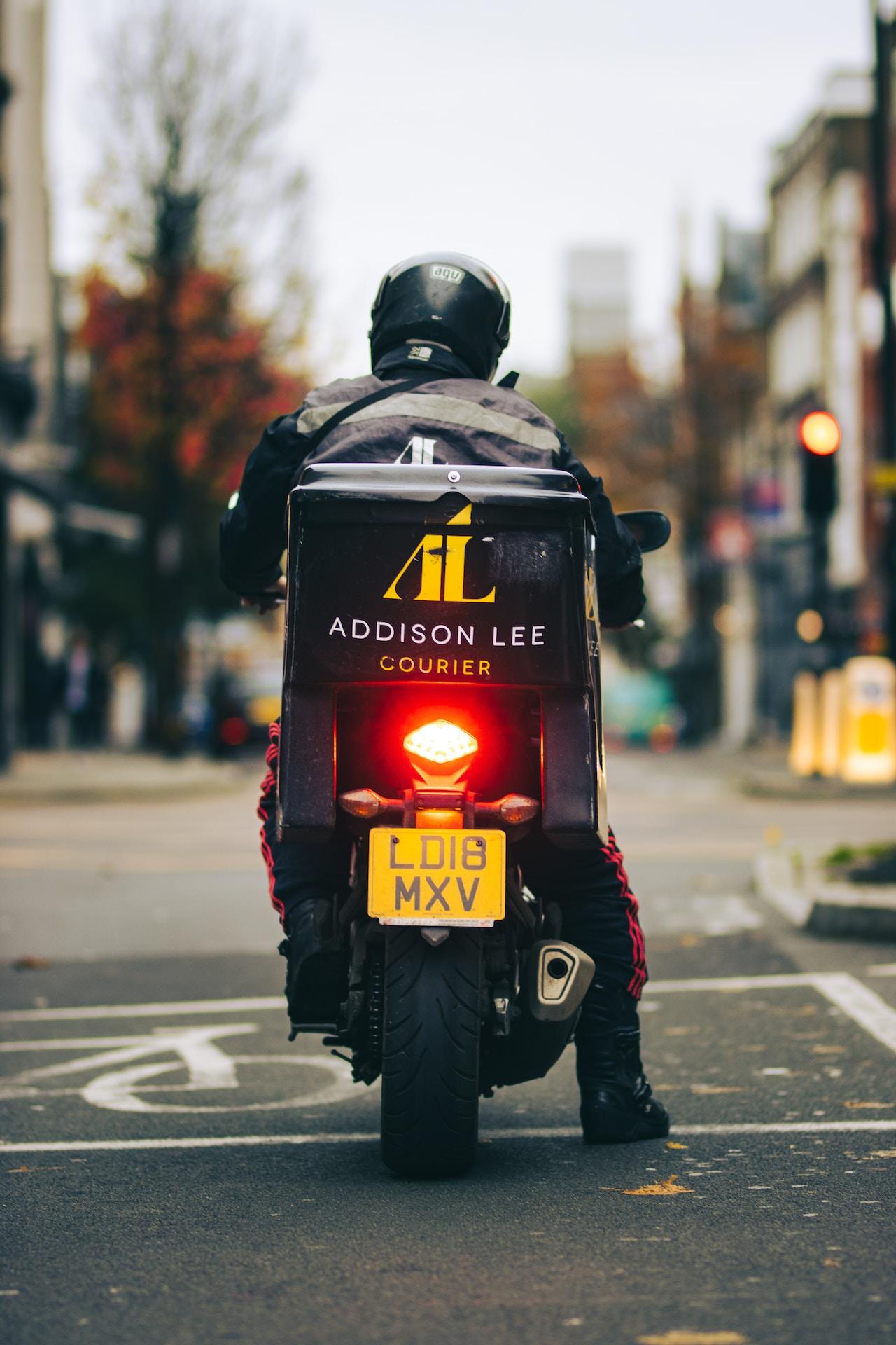 man in black helmet and black jacket with helmet on road during daytime