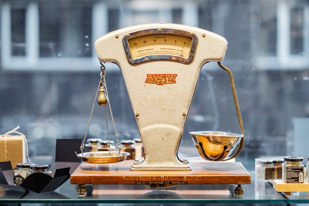 brown and beige weighing scale