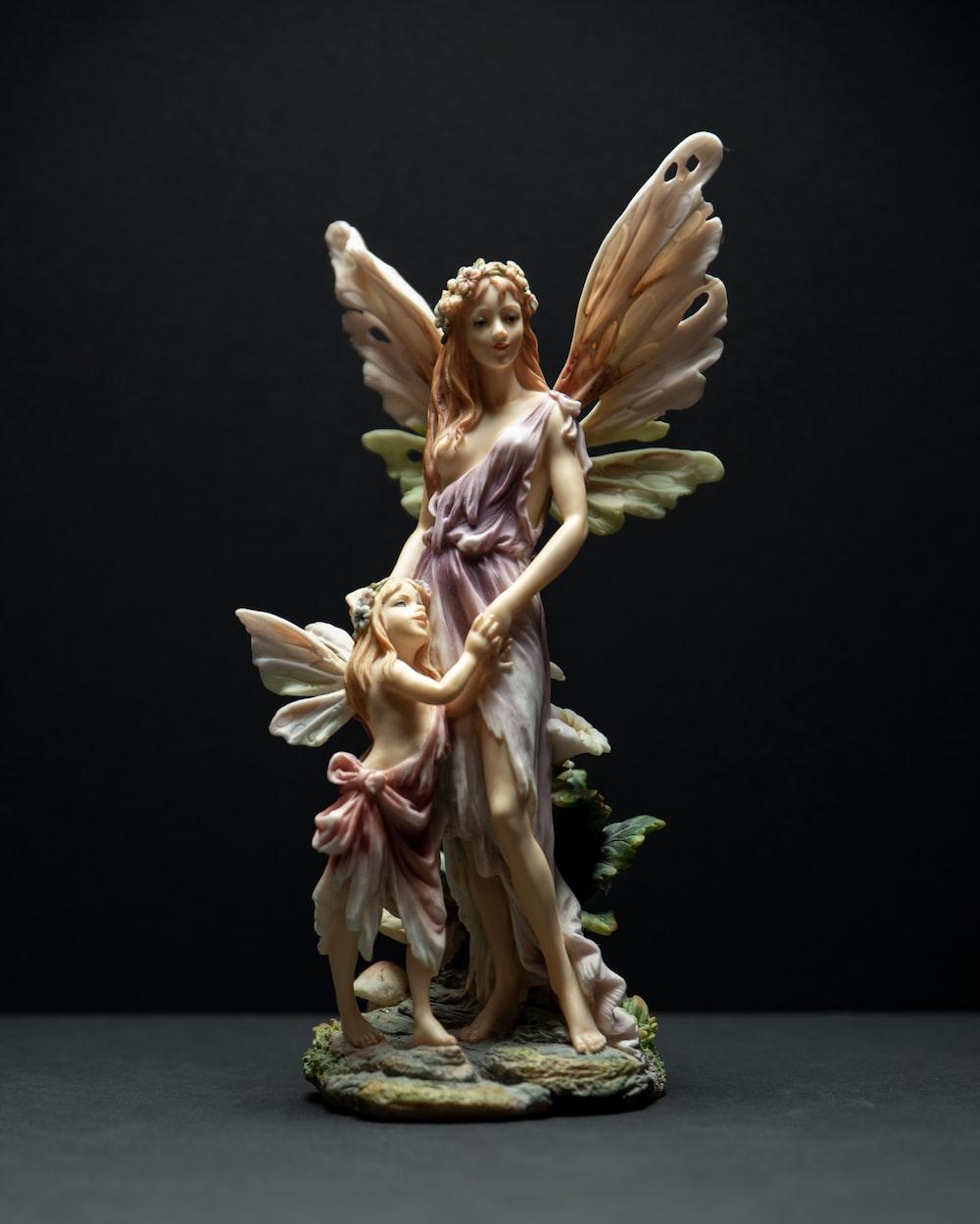 angel holding flowers ceramic figurine