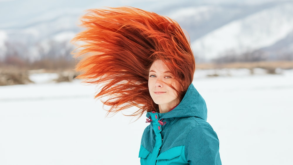 woman in blue hoodie with red hair