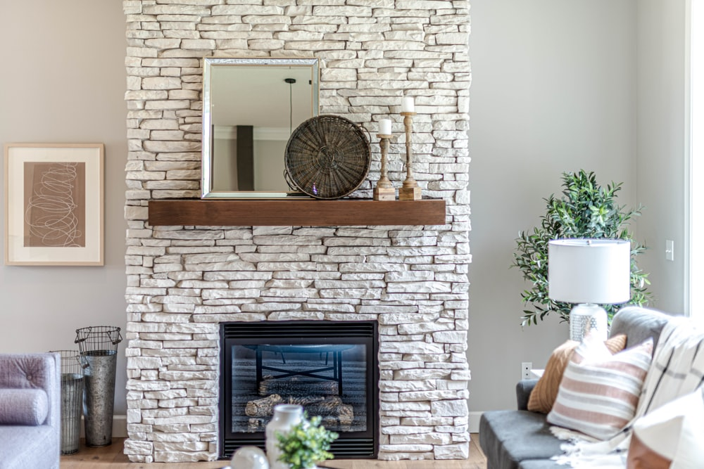 black fireplace in brown brick wall