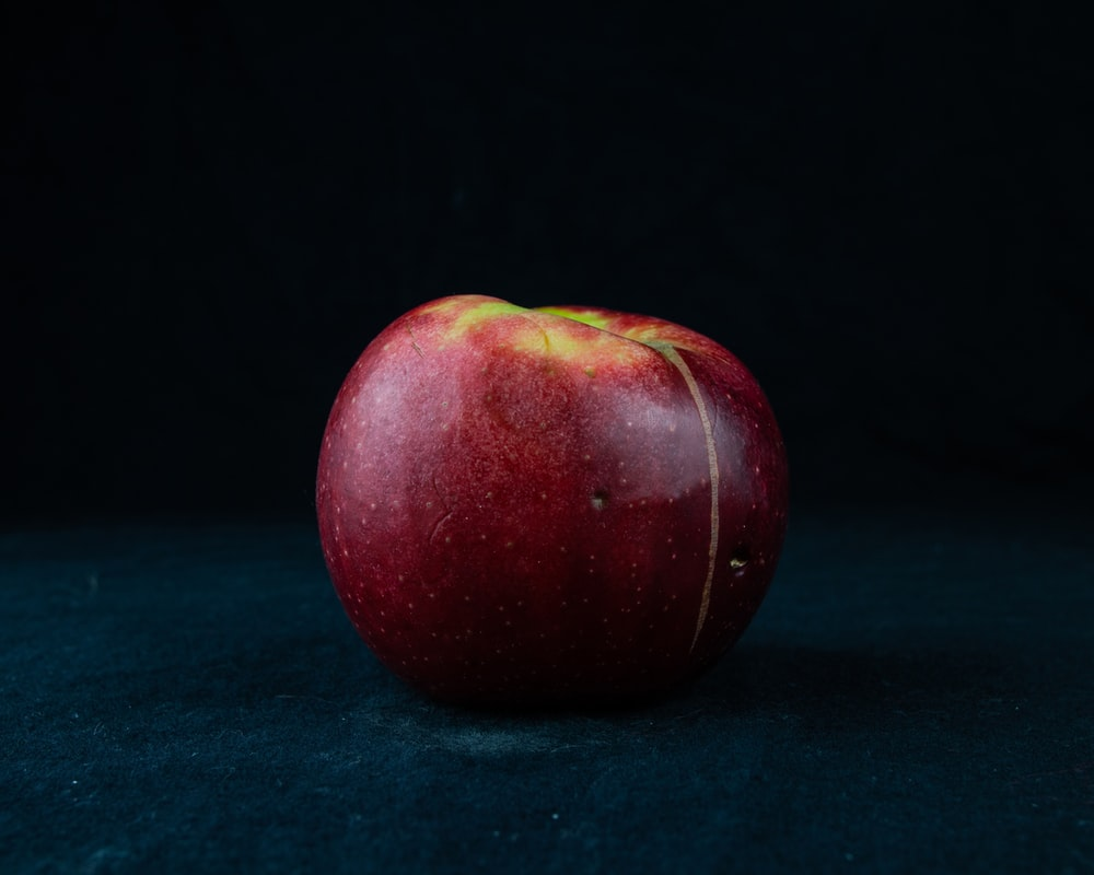 red apple on green textile