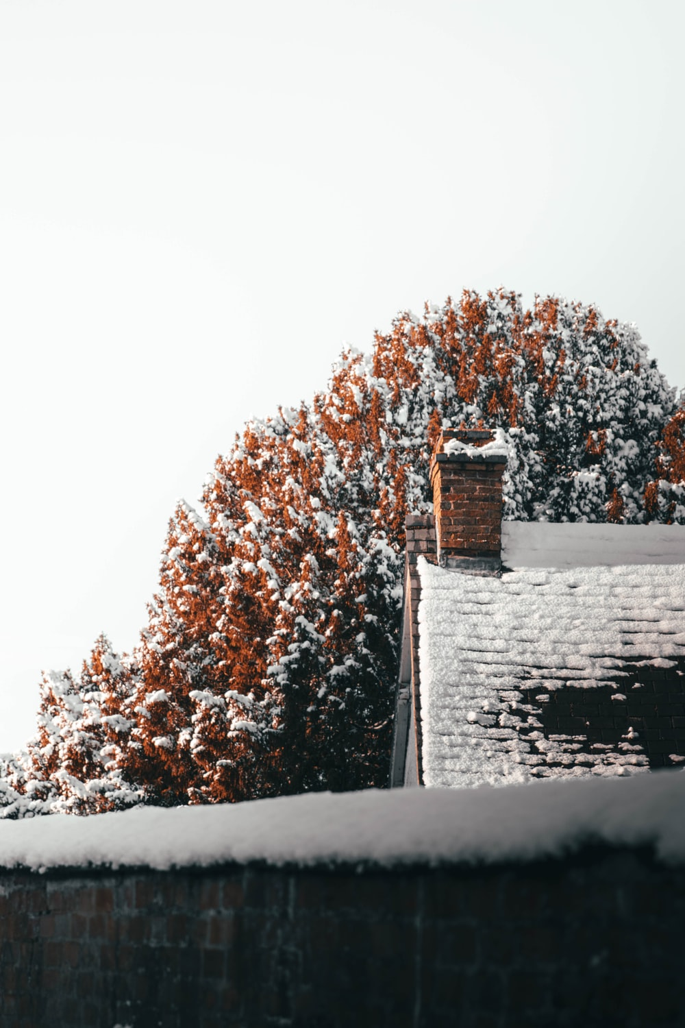 brown and white house covered with snow