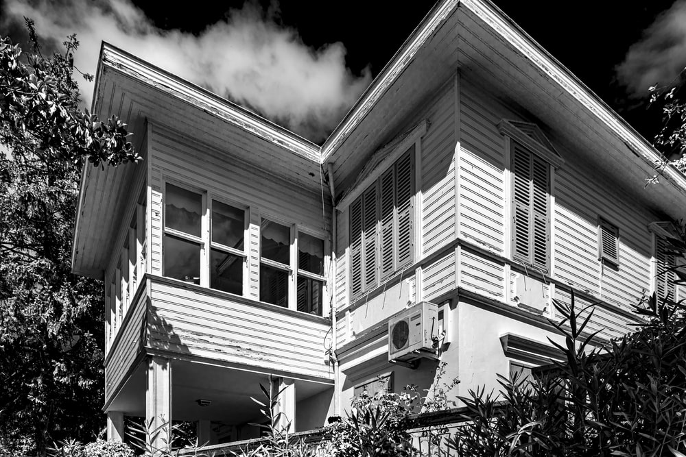 grayscale photo of 2 storey house