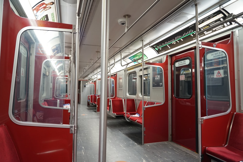 red and white train in train station