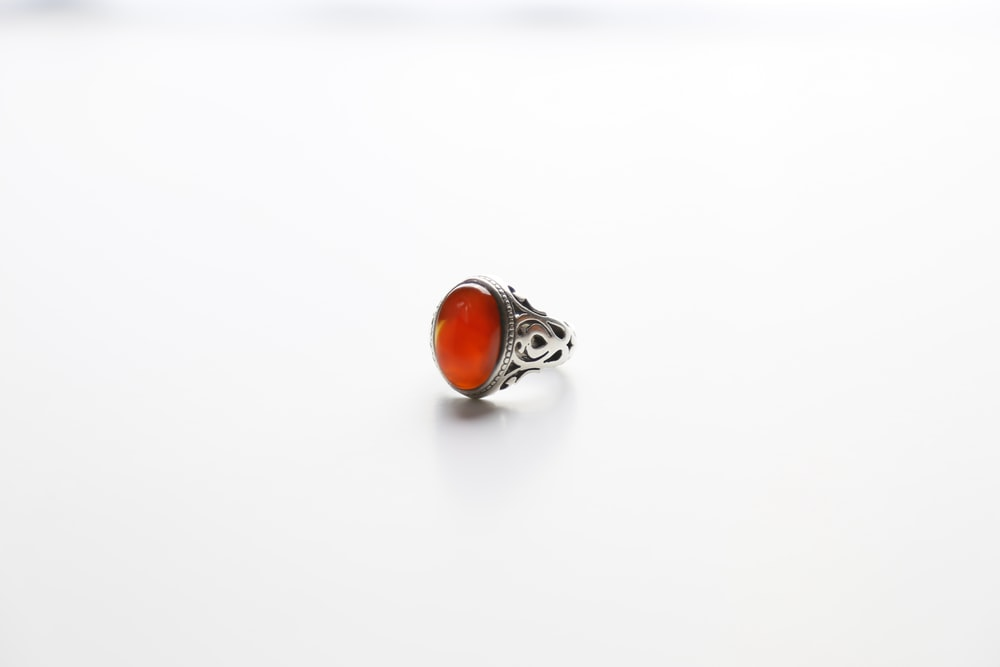silver and orange stone ring