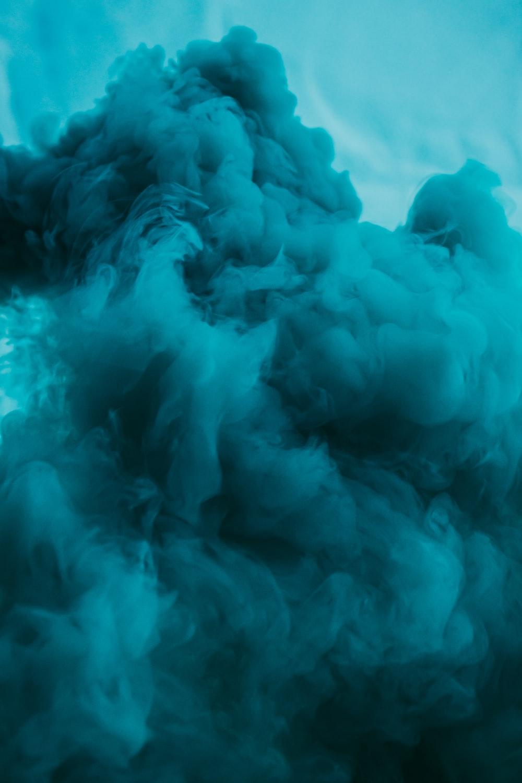 white smoke on blue sky