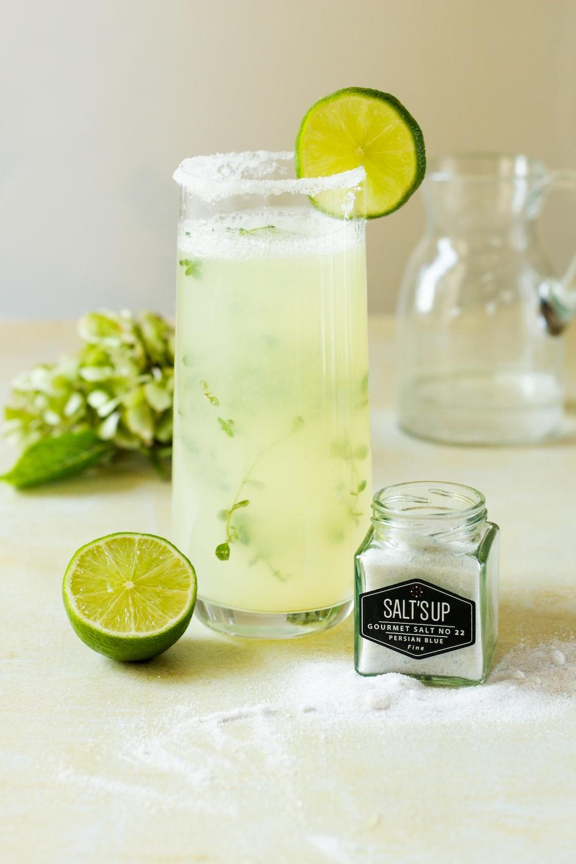 lemon juice in clear glass bottle