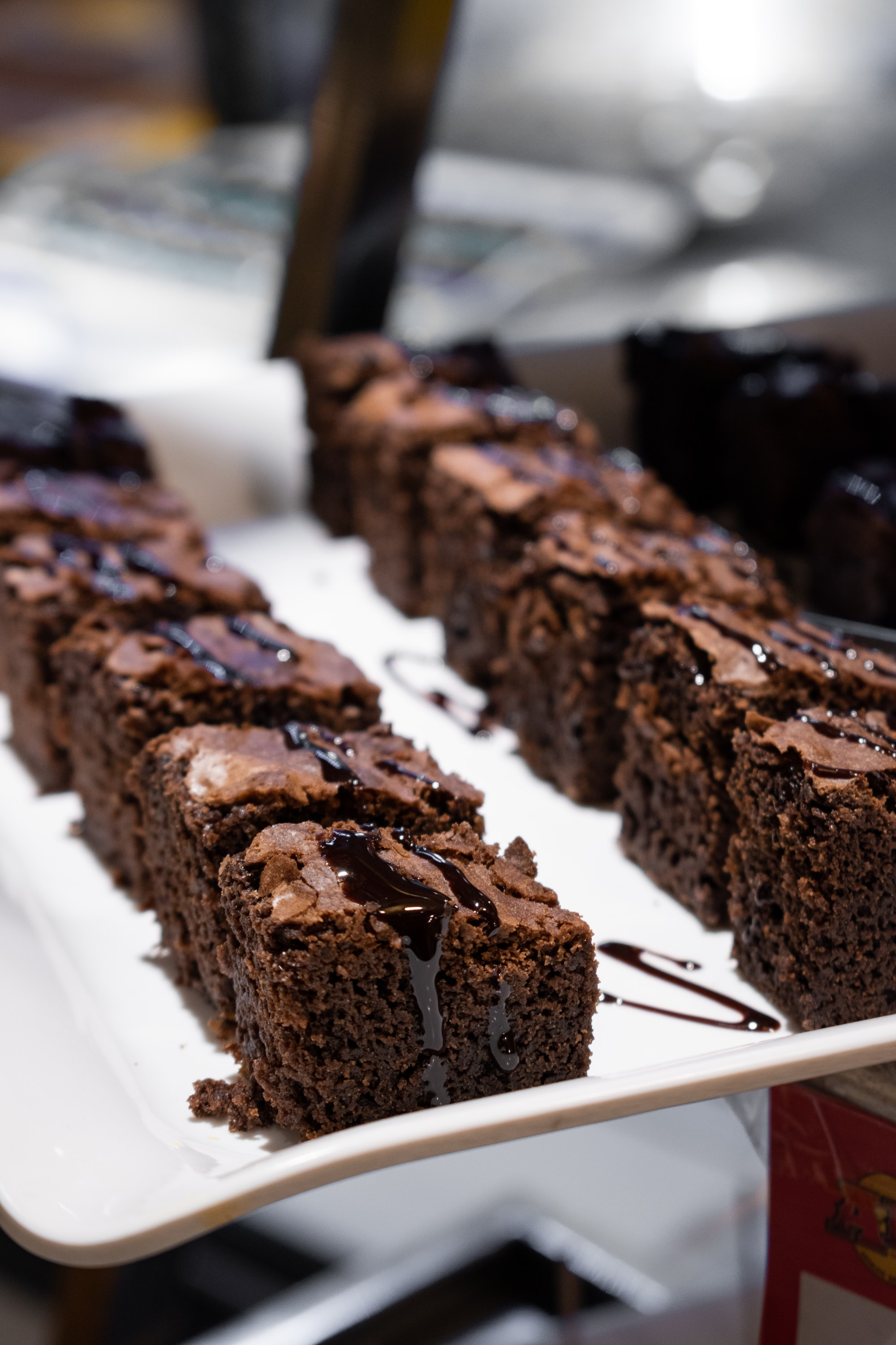 Chocolate Brownies With Chocolate Syrup - Must-have dessert in Wedding Reception