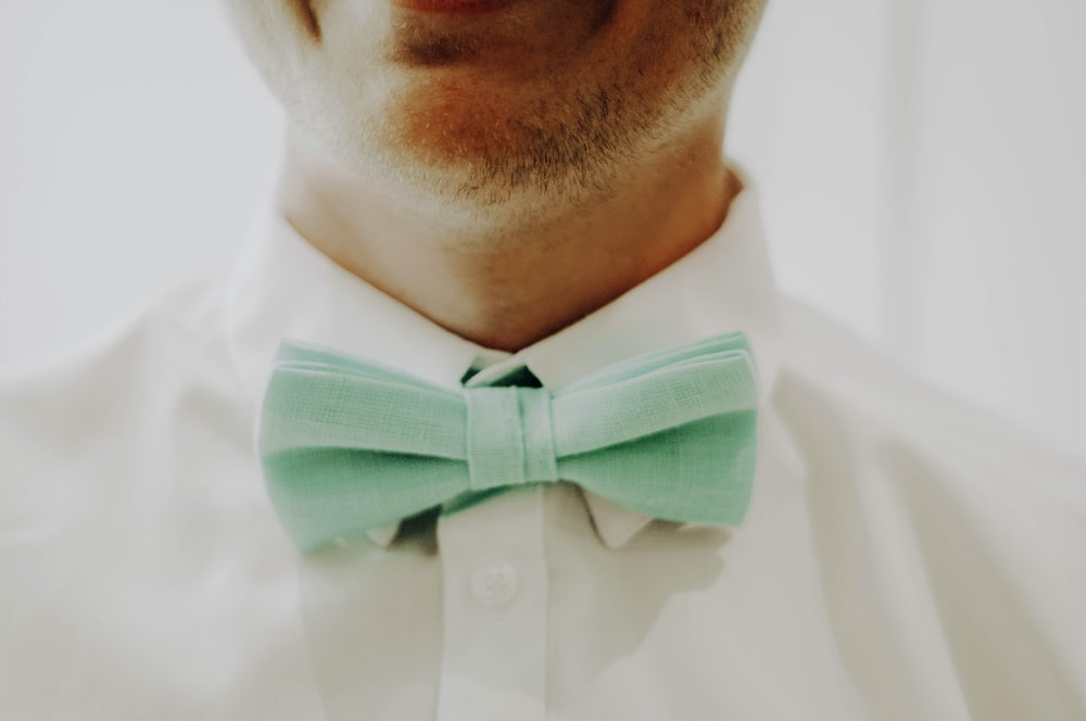 man in white dress shirt with black bowtie