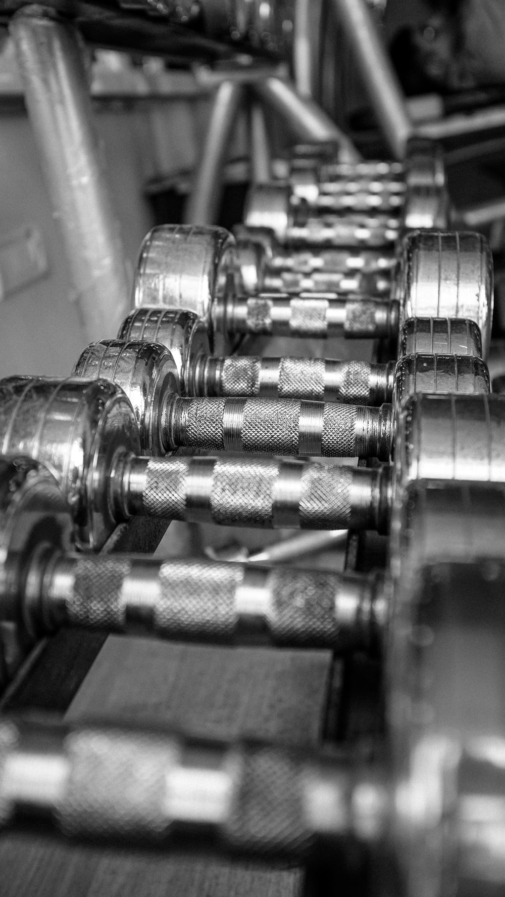 silver dumbbells on brown wooden table