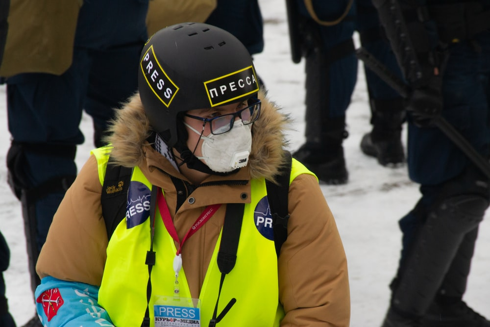 woman in yellow jacket wearing black helmet