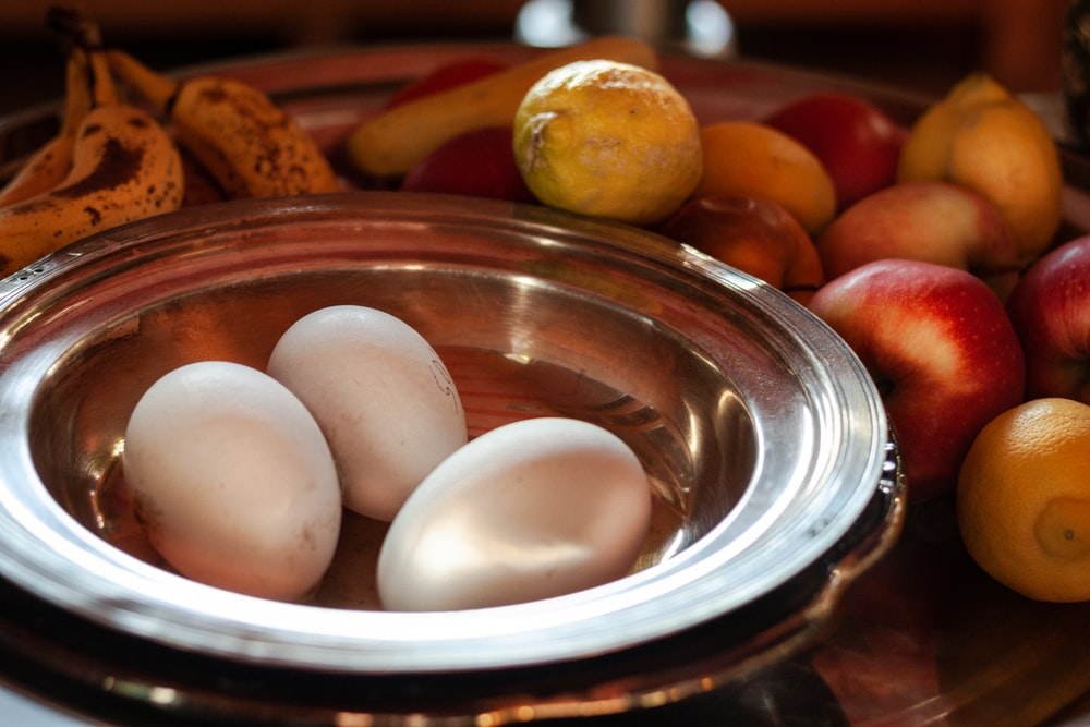white egg on stainless steel round plate