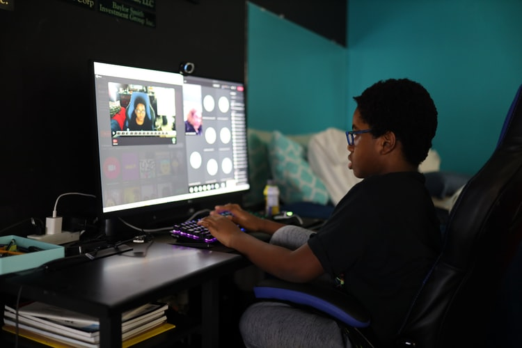Child having online zoom lessons and enrichment classes