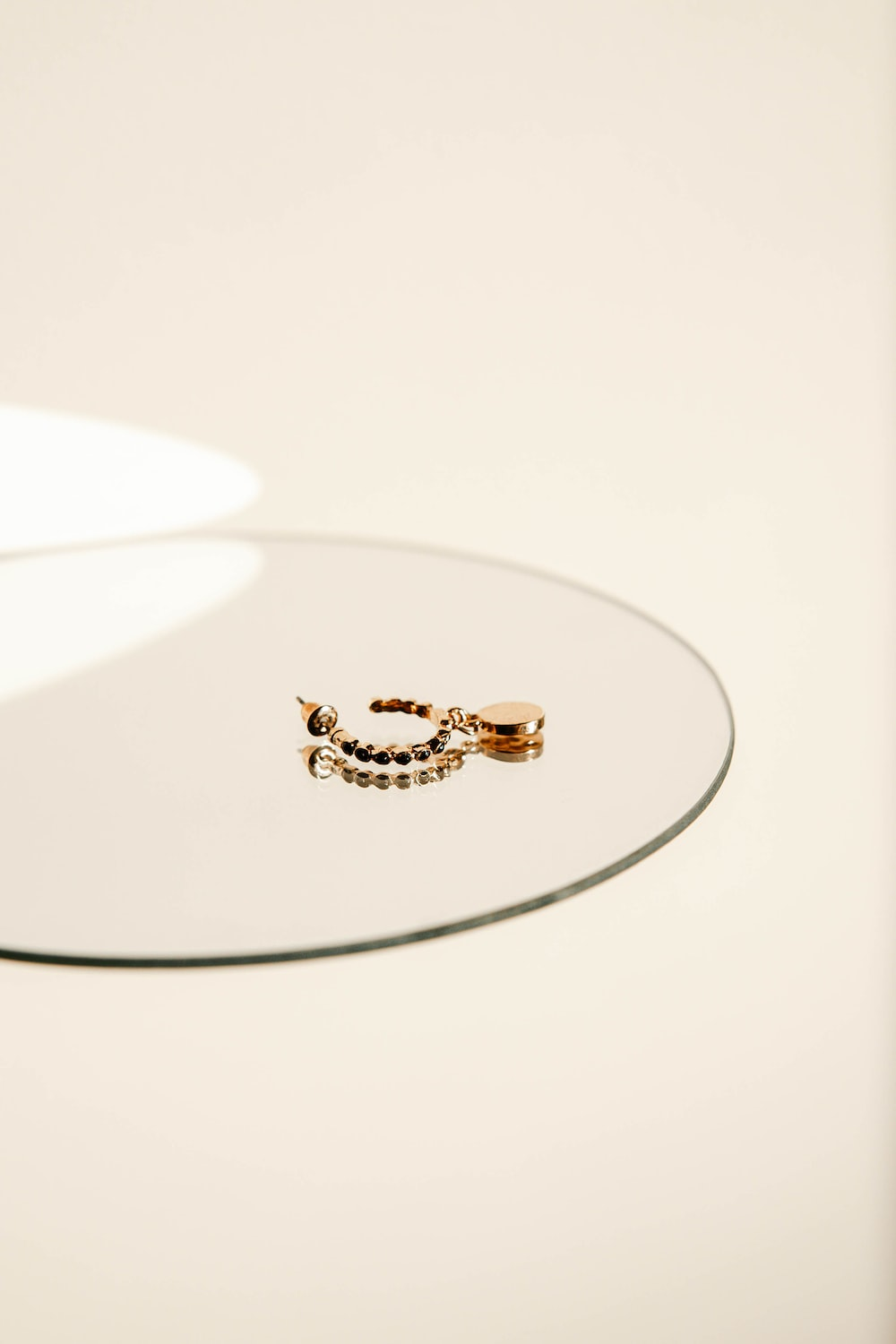 gold and diamond ring on white surface
