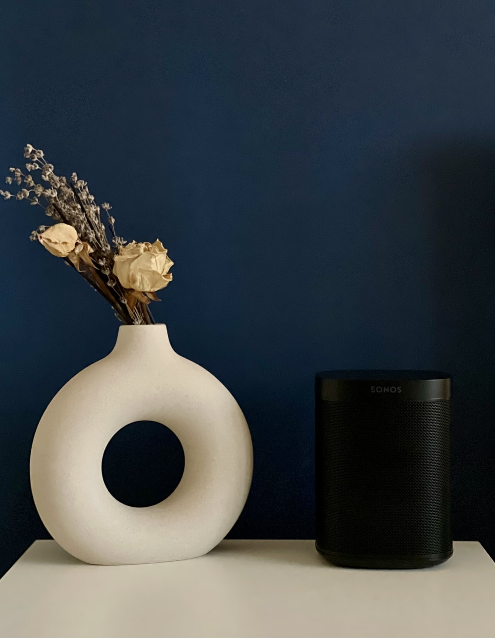 yellow flowers in white ceramic vase