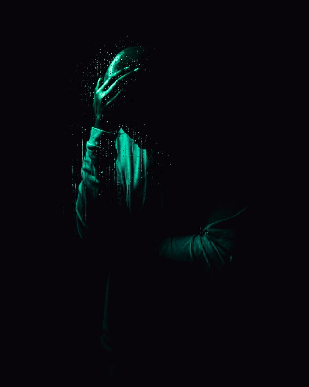 person in black hoodie jacket