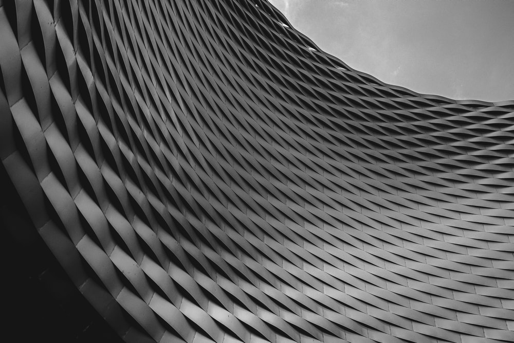 worms eye view of gray concrete building under cloudy sky during daytime