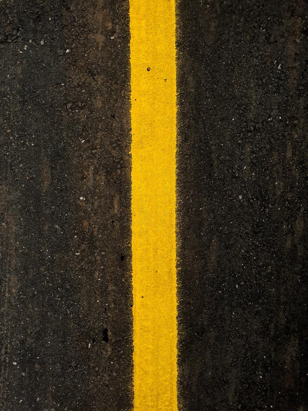 yellow line on black sand