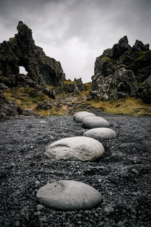 white rocks on gray rocky ground